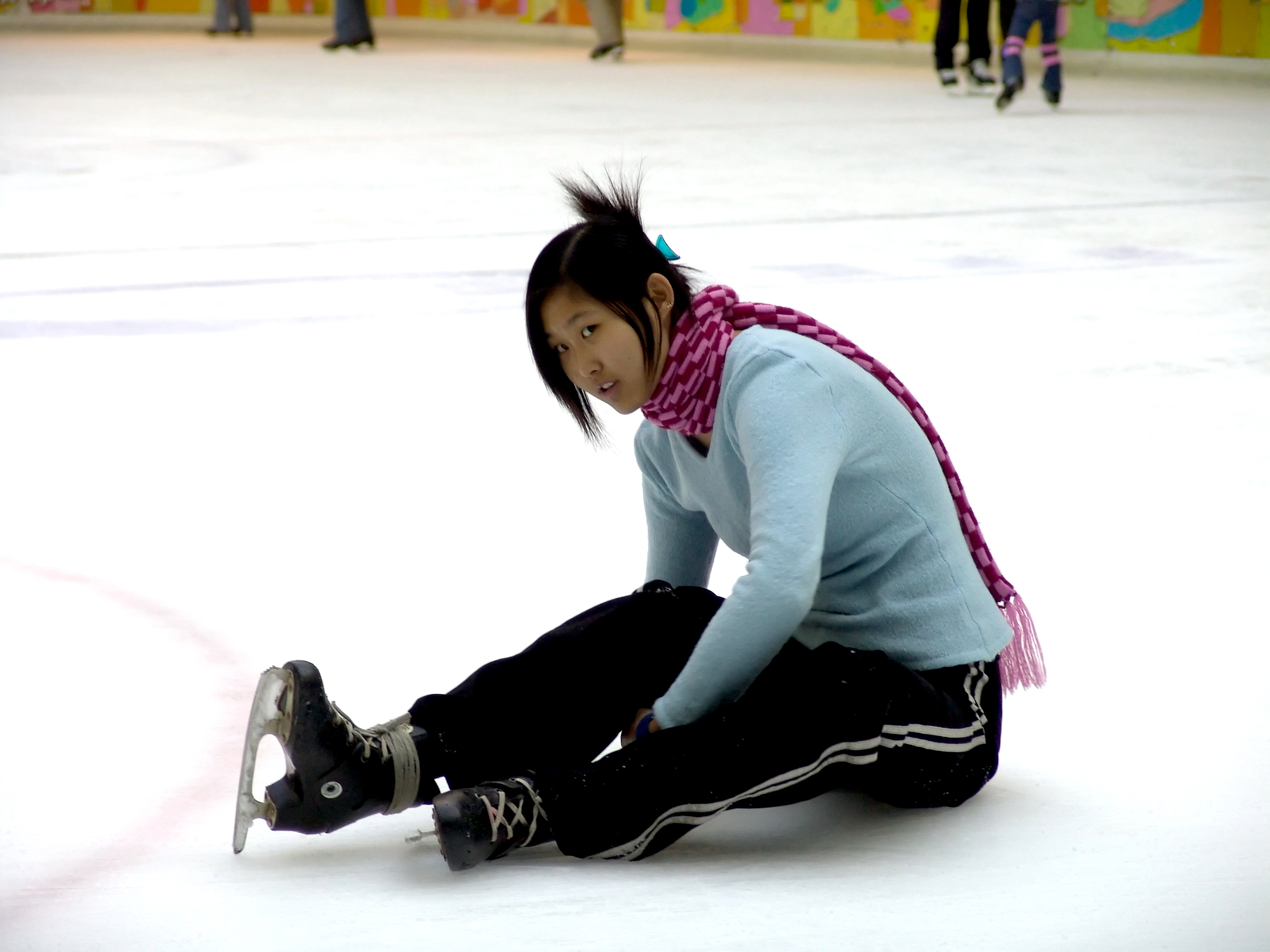 Girl_sitting_down_on_the_ice-rink_(01913)